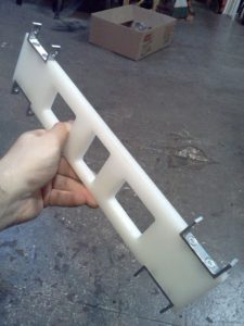 Leg with brackets for rollers.